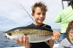 Happy kid with a nice tuna!